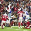 NFL: Cowboys wrestle Arizona in spite of a wobbly start